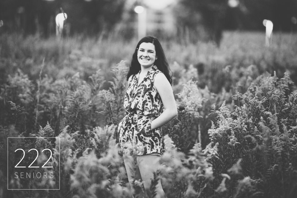 black and white senior pictures in a wildflower field
